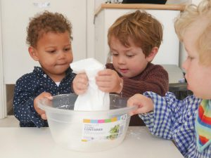Boys making bread at Hove Village Day Nursery